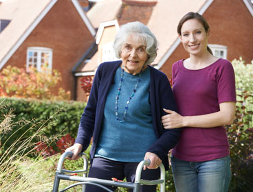 caregiver-with-standing-woman